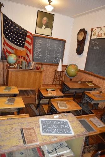 School classroom display with old desks, globe and chalkboard