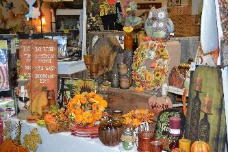 Table and display of products at Seasons by Design