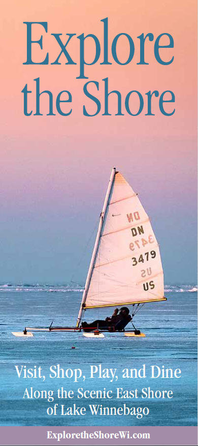 Sailboat on lake with pastel sunset in background